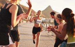 woman running marathon win success.jpeg