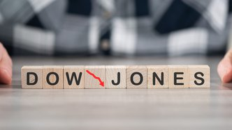 Dow Jones plunges 500 points after Federal Reserve paints dire picture