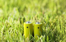two batteries in green grass field