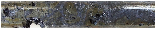 Massive sulphides – typical galena (grey-blue) with pyrite (bronze colour), diamond core from AF005, 82.1m. Strong lead mineralisation is intersected over 9.4m length in this particular hole.