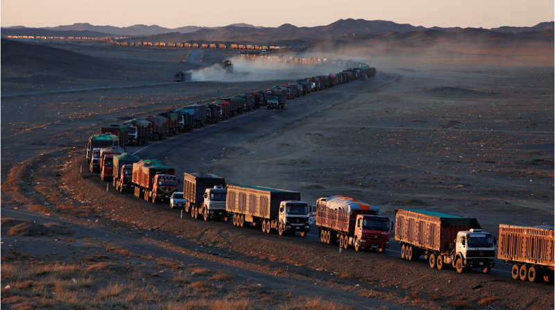Coal trucks taking coal from Tavan Tolgoi to China, Source: Reuters