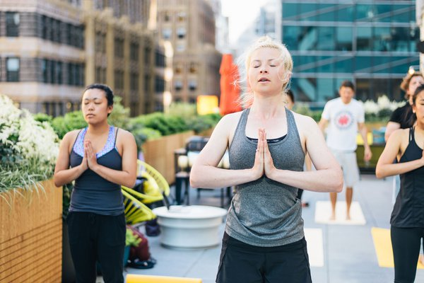 WeWork's rooftop yoga experience.