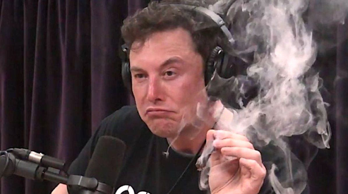 Elon Musk takes a drag